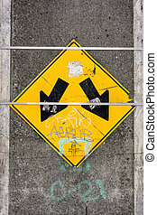 Sign With Two Arrows - A directional traffic sign on a...