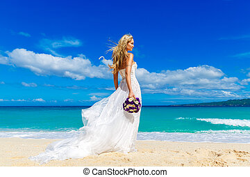 beautiful blond fiancee in white wedding dress with big long...