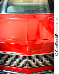 Close Up Detail of Shiny Red Classic Car.