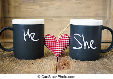 Valentines day tea - Cup with words He and She written with...