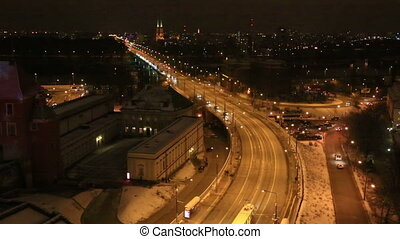 Traffic on a platform at night, Warsaw