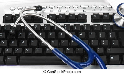 Stethoscope on a keyboard - Stethoscope and folders on a...