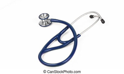 High angle of a stethoscope spinning against white