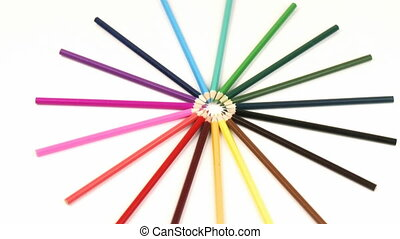 Colour pencils in a circle turning like a wheel against...