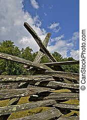 Railing fence posts - A wooden weathered fence with rails...
