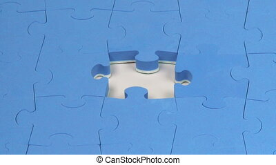 Hand placing the last piece on a puzzle