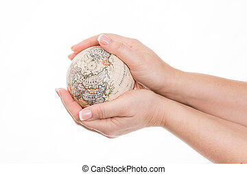 world market - female hand holding a little globe against...