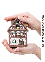 timbering - female hands holding a timbering little house...