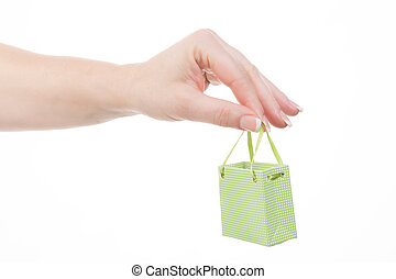 environmentally friendly shopping - female hand holding a...