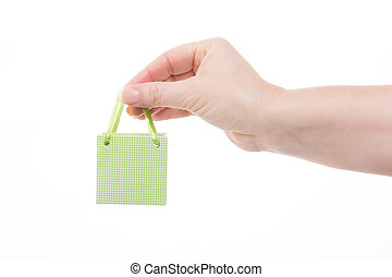 cheap offers - female hand holding a little green shopping...