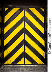 Yellow Black Door - Yellow and black warning stripes on...