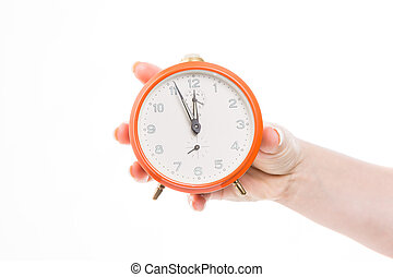 hustle and bustle - retro orange alarm clock shows five...