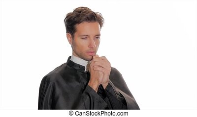 catholic priest saying a prayer - portrait of clergyman...