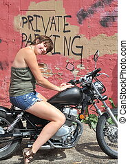 Biker gal - Biker gal on her motorcycle outside
