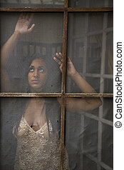 Young Indian Woman Gazing out Old Screen Door - Beautiful...