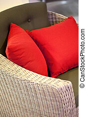 Cushions - Red cushions on a wicker sofa