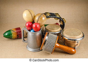 Percussions - Image of latin percussion set on brown sack...