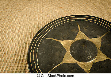 Ancient Thai's gong - Image of ancient Thai's gong on brown...