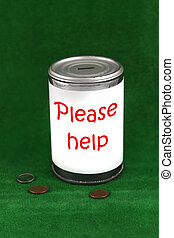 Donation can - Change laying beside a donation charity tin...