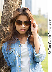 closeup portrait smart women and eyeglass with jeans fashion
