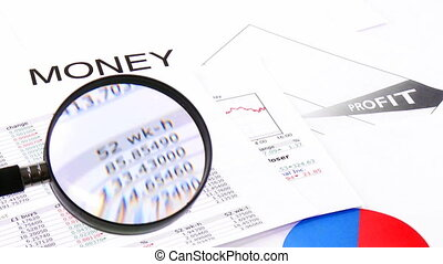 Magnifying glass showing business profits - Close-up of a...