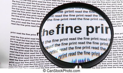Magnifying glass showing words from a newspaper - Close-up...