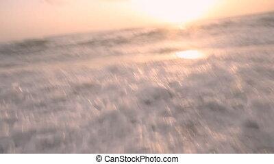Surf autumn sea at sunset - Sea foam surf at sunset