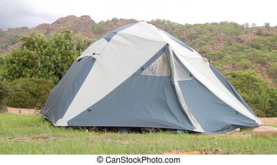 tourism camp and tent in mountains - Camping tent on...