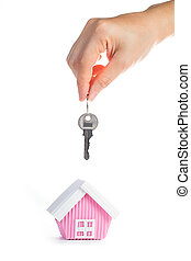 Real estate concept with hand holding key - Real estate...