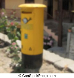 Blurred yellow letter box. Cyprus.