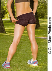 Fit body - Young athletic woman with perfect buttocks and...