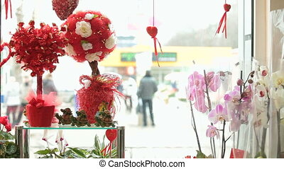 Shop window display with flowers and gifts for Valentine's...