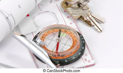 Blueprints, compass and keys turning
