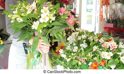Florist Making Bouquet In Flower Shop