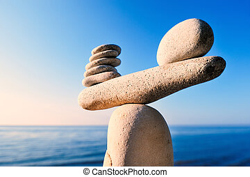 Well-balanced - Balancing of white pebbles on the top of...