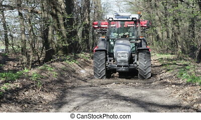 tractor with plow move - SMELA, CHERKASSKAYAUKRAINE - APRIL...