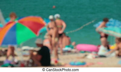 People at the summer beach vacation out of focus