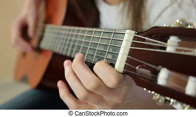 Young Girl Playing Guitar Close-up
