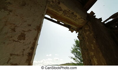 View of rural landscape from the window of old abandoned...