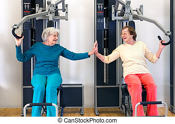 Old Ladies Exercising While Touching their Palms - Smiling...