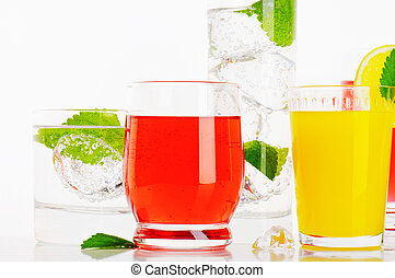 Variety of cold drinks - Glasses of fizzy water and...