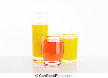 Glasses of fruit juice drinks on white background