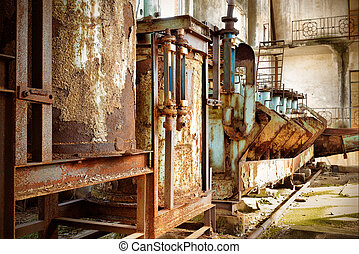 Abandoned factory, rust-stained machine.