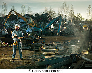men at work in recycling center - caucasian engineer...