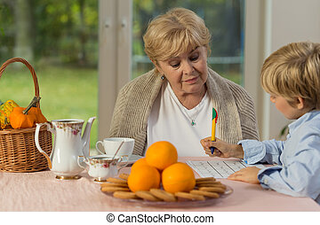 Doing homework - Cute little boy doing his homework with his...