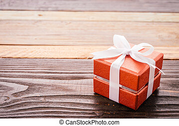 Gift box on wood background - vintage effect style pictures