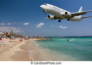 Landing plane - White clean plane landing over beach in...