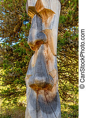 tree trunk carved face - tree trunk, carved face, symbol of...