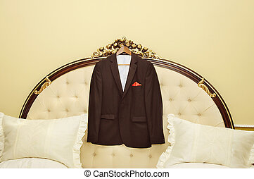Suit jacket hanging on a hanger