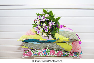 Wedding bouquet for bride on the pillows